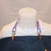 attache serviette de table motifs fleurs fond bleu